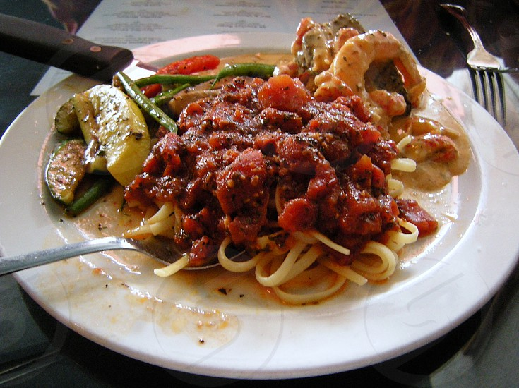Spaghetti with seafood and roasted vegetables photo