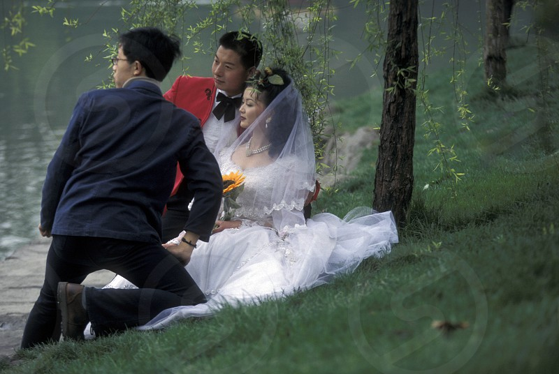 a chinese Wedding couple in a parc in the city of Chengdu in the provinz Sichuan in centrall China. photo