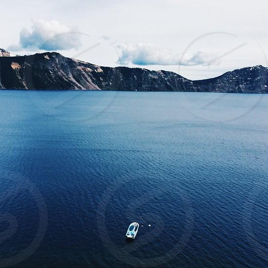cruise ship with mountain range photo photo