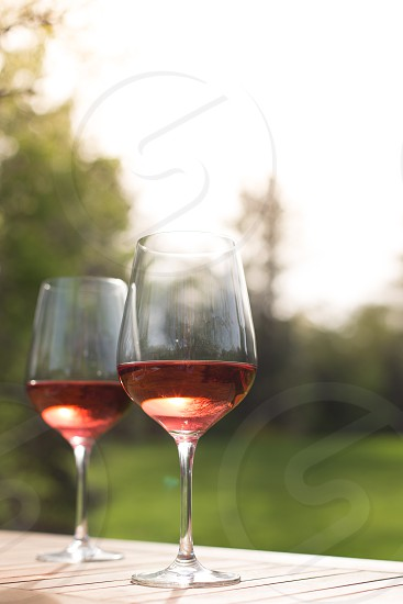 Glasses of rose wine outside photo