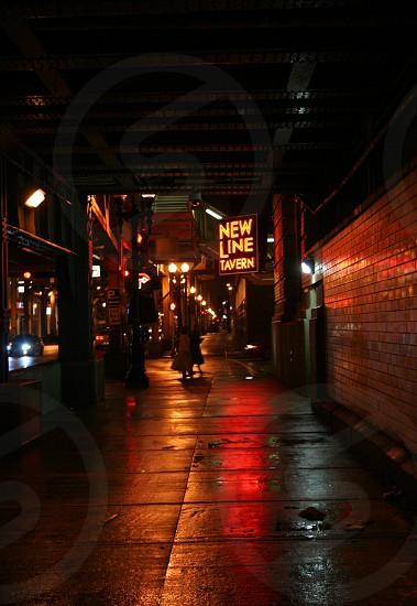 Lights reflecting of rainy Chicago sidwalk photo