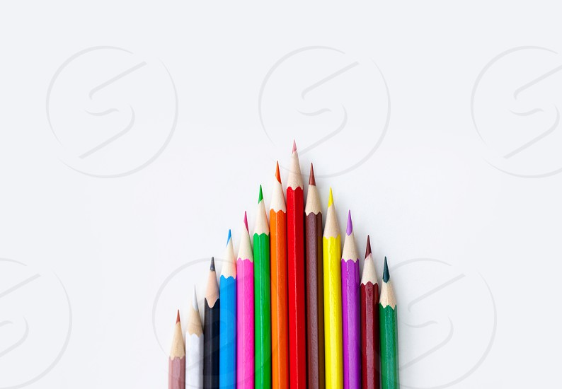 Art and drawing creative concepts of colorful crayon pencils with triangle shape on white background with copy space. Top view Close-up For banner design. photo