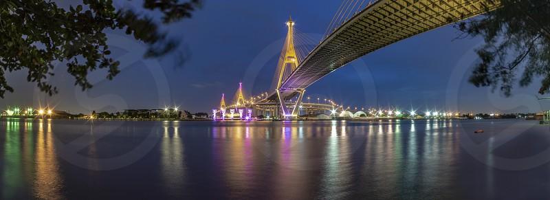 Pnorama Bhumibol Bridge Chao Phraya River Bridge. Turn on the lights in many colors at night. Pnorama photo