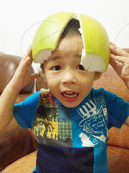 boy wearing pomelo peel photo