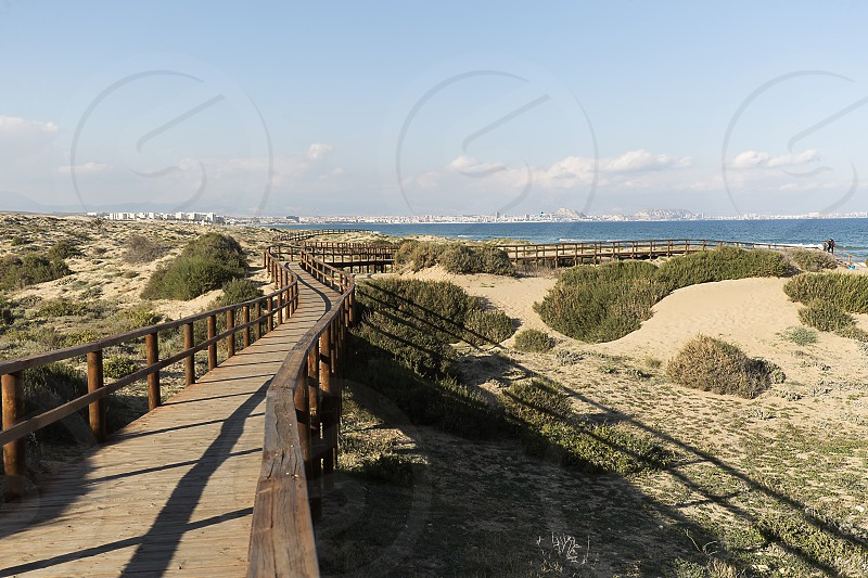Wooden walkway in the Arenales del Sol municipality of Elche in the province of Alicante in Spain. photo