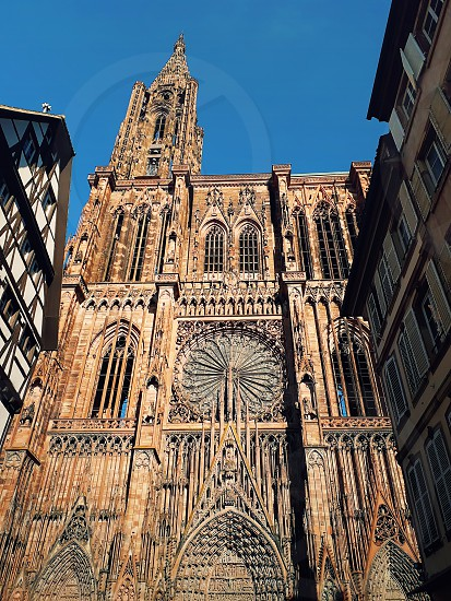 Main entrance of Roman Catholic Cathedral Notre Dame de Strasbourg in Alsace France. Beautiful sunny day with clear blue sky. Majestic gothic architecture. photo