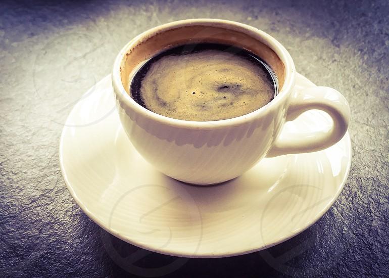 closeup photo of white ceramic teacup with saucer photo