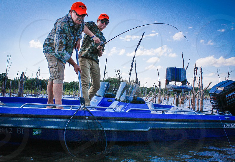 Father son fishing lake boat summer sport photo