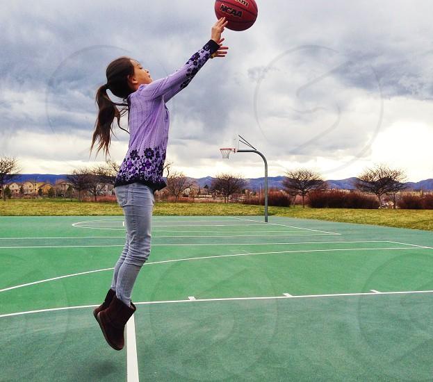 Girl Shooting Basketball photo