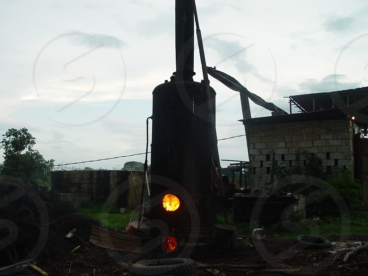 Rugged antique boiler fueled by wood. photo