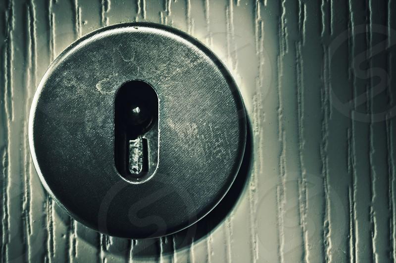 Closeup view on old used door lock in white doors. photo