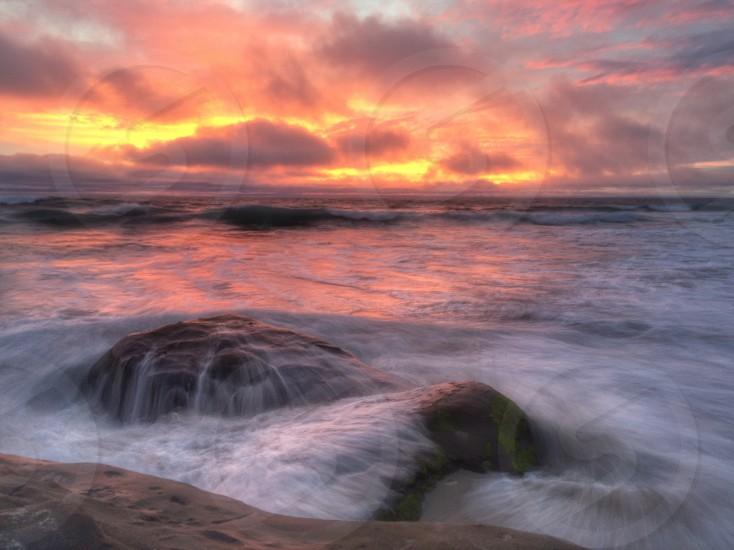 Sunset orange clouds rocks beach la Jolla Windansea California red warm smoky nature ocean passion photo