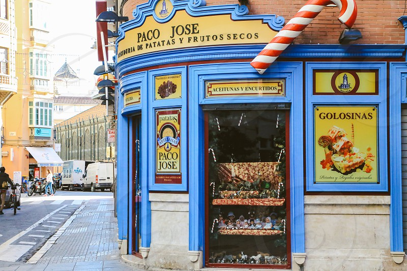 Storefront  candy snacks outdoors open display  hut Spanish  candy store  photo
