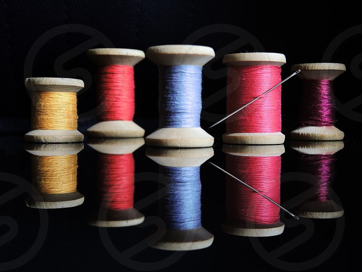 assorted color sewing thread with needle photo
