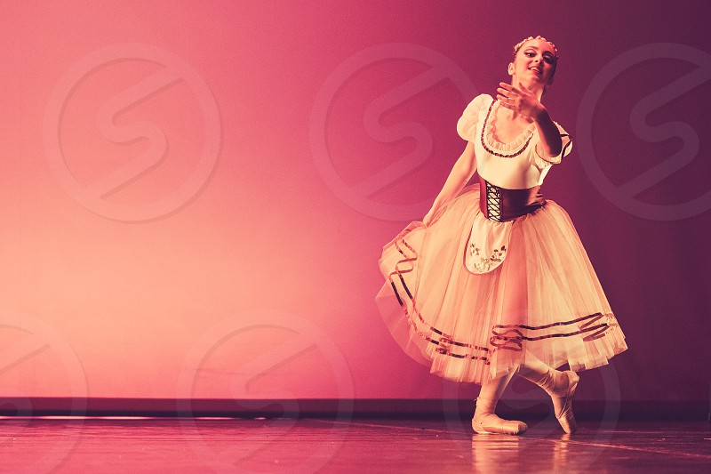 Young Beautiful Ballerina Dancing photo