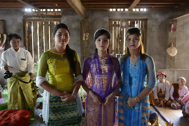 a women in a traditional dress at a shinpyu ceremony in a village neat the city of Myeik in the south in Myanmar in Southeastasia. photo