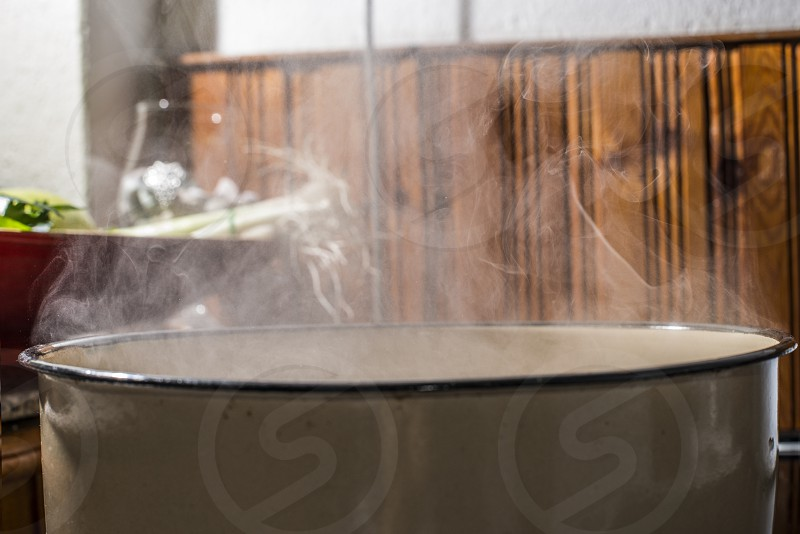 Boiling water in a saucepan. Vintage kitchen photo