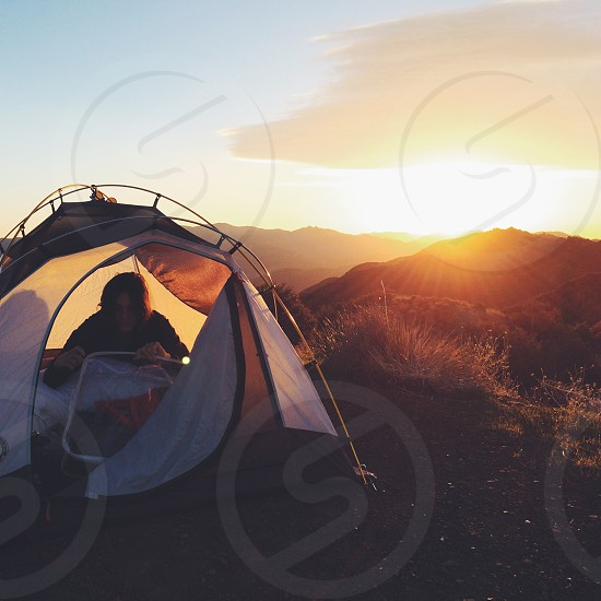 man sitting in a tent photo
