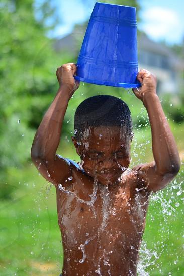 Summer water splash bucket photo
