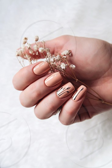Creative manicure beige color photo