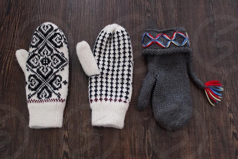 3 white and black winter mittens photo
