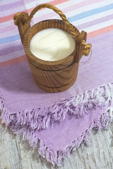 Vintage small wooden mug of milk. Bulgaria Plovdiv photo