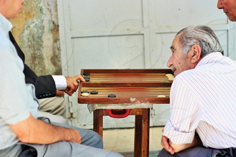 man talking to other 2 men photo