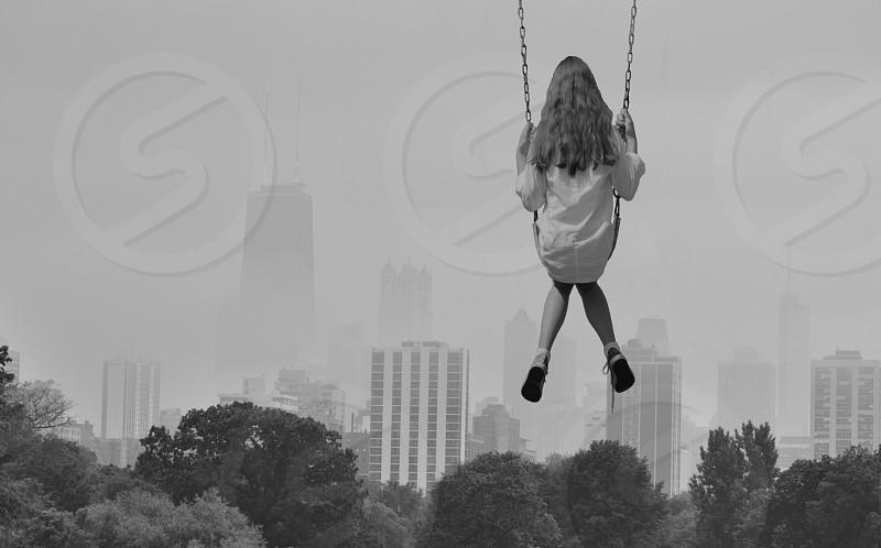 girl playing swing chair photo