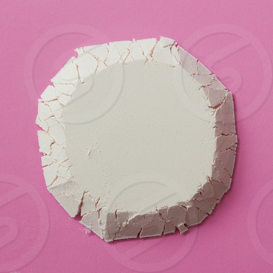 Circle made from flour isolated on a pink background close-up flat lay photo
