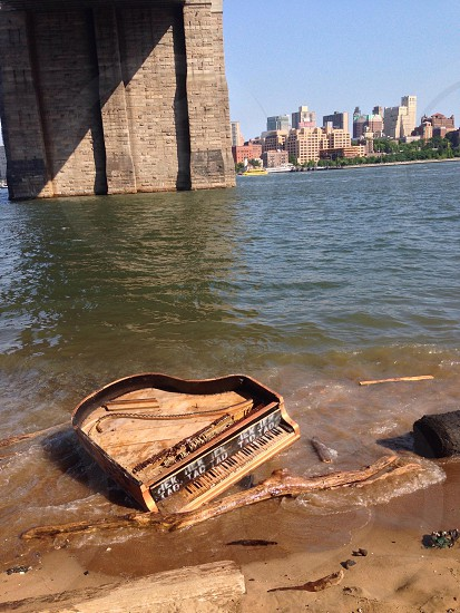 Abandoned piano. East River NYC photo