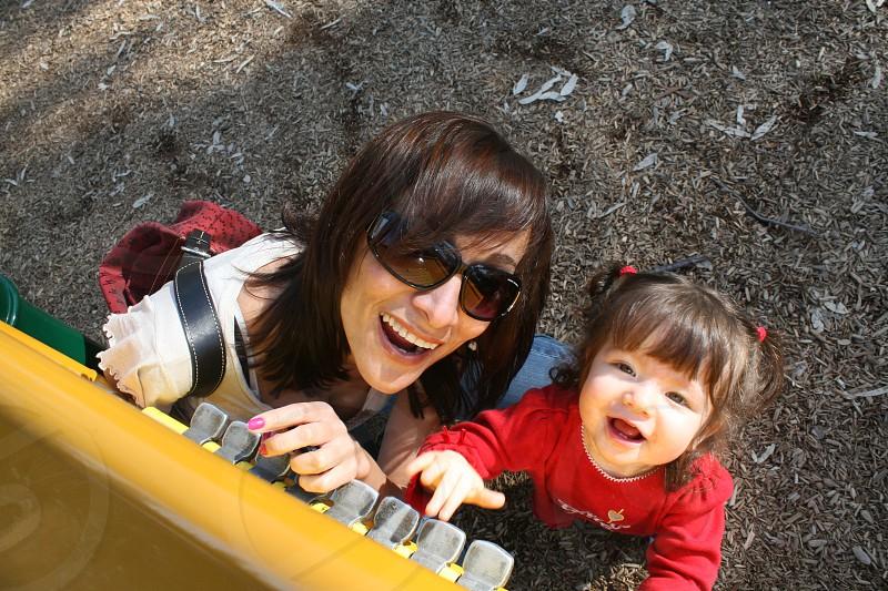 mom mother daughter family park playground fun smiles photo