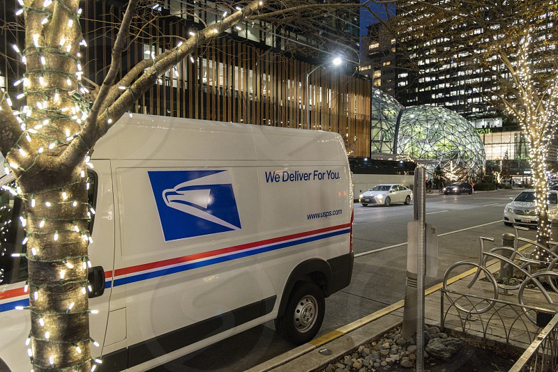 Postal service van at night during the holiday season in Seattle. photo