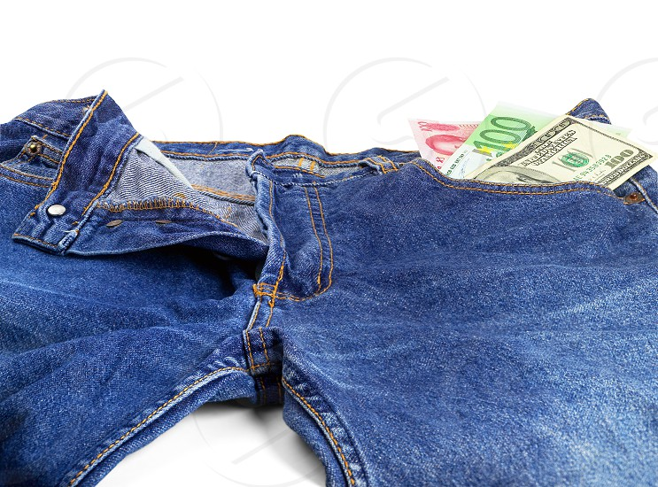 money bills on pocket of a pair of blue jeans photo
