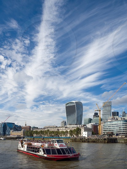 Tourist Boat Cruising along the river Thames photo