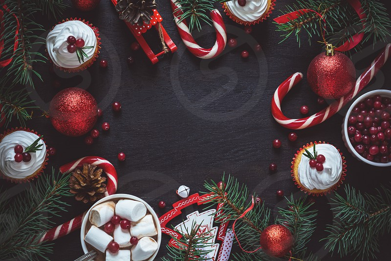 Christmas decoration. Hot chocolate with marshmallow on black wooden background photo