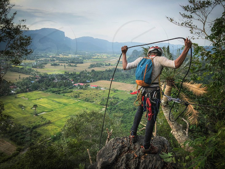 rope black limestone rock climbers climbing abseiling repelling rock  photo