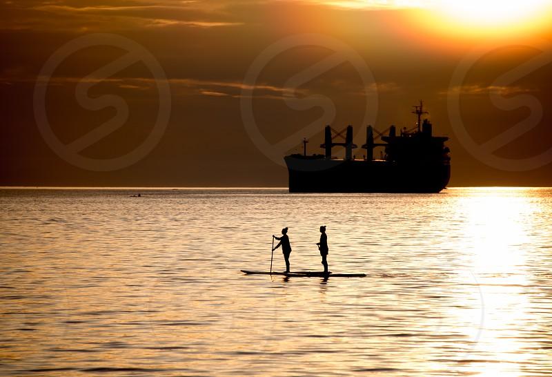 Golden sunset paddle photo
