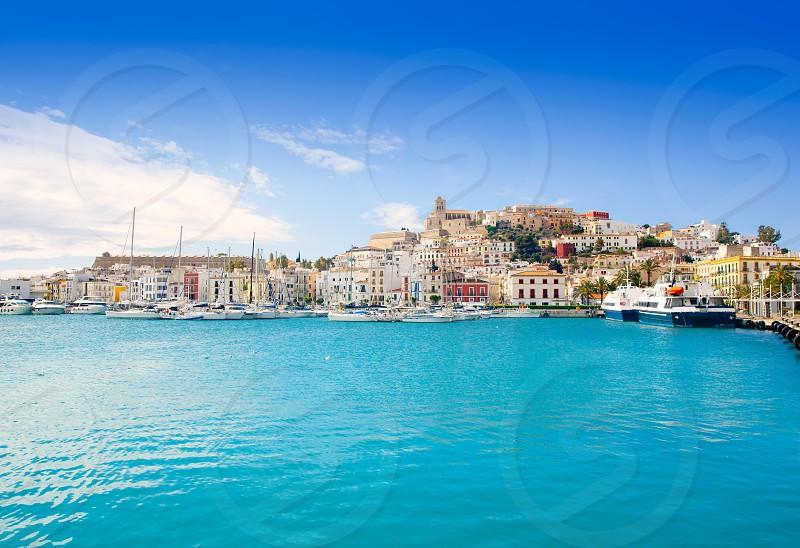 Eivissa Ibiza town with church under summer blue sky photo