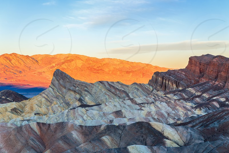 Famous Zabriskie Point at sunset in Death Valley National Park. California. USA photo