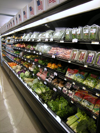 Vegetable section of supermarket photo
