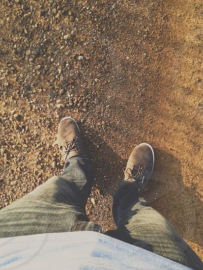 person wearing blue denim jeans photo