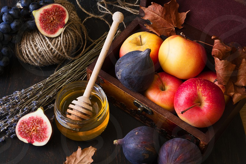 autumn fruits apples grapes figs and honey photo