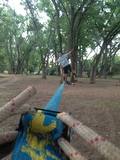 Slack lining is fun and relaxing  photo