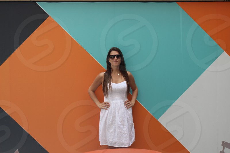 woman in white spaghetti strap dress and black sunglasses photo