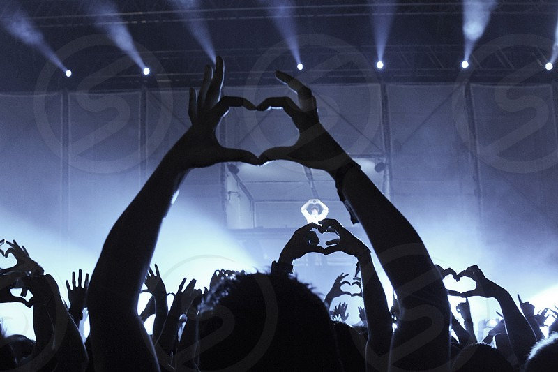 heart shape with hands at concert photo