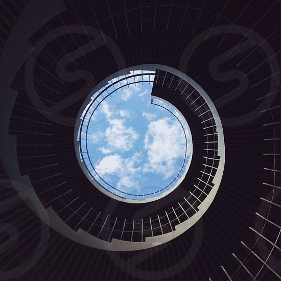 black wooden stairs and blue sky photo