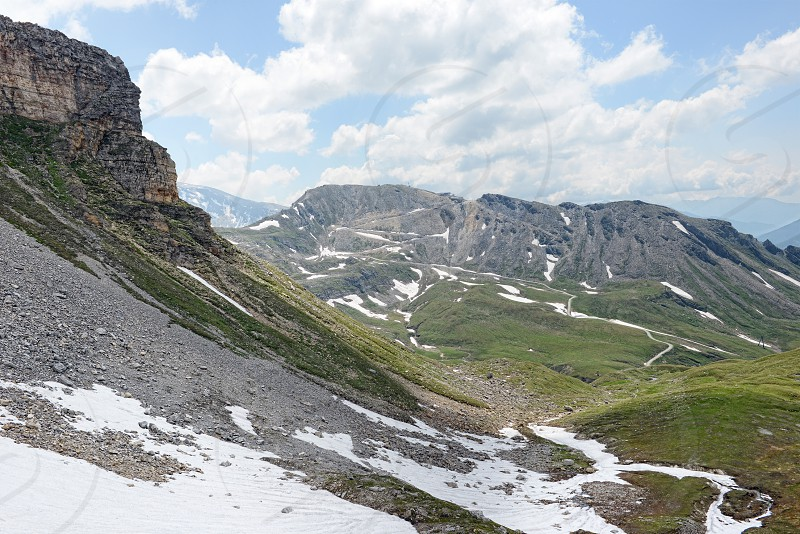 Grossglocker mountain area with snow in summer time photo