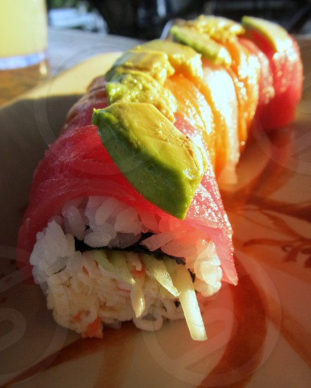 Sushi rainbow roll in sunlight photo