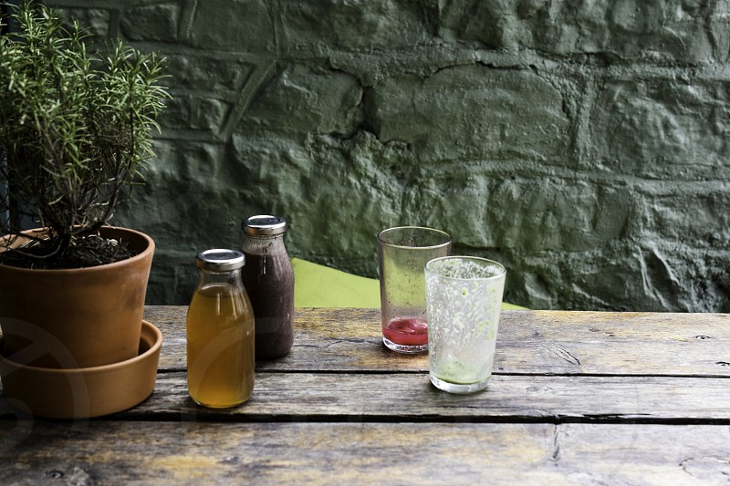 Bottled of healthy juice on cafe table/ photo