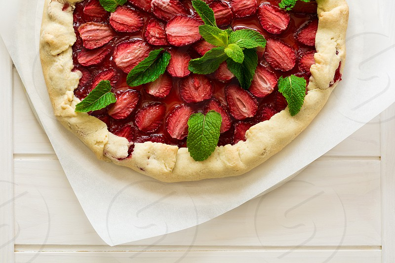 strawberry berry delicious crust dessert sweet red leaf summer homemade gourmet pie custard round bakery bake lunch cake pastry tart wooden vintage galette fruit background food mint syrup rustic seasonal traditional cook fancy baked harvest juicy summertime slice white spring organic healthy freshness ripe dough snack handmade season wood tasty top view  photo